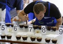 <p>A judge smells the aroma of a specialty coffee at the Cup of Excellence competition in Machado November 13, 2009. National and international judges spent all week sniffing, savoring and spitting, in order to single out the best coffee in Brazil from the last 56 in the running during the annual Cup of Excellence. Despite heavy rains during harvesting that spoiled large quantities of Brazil's beans this year, judges said the quality of top tier coffees had improved. REUTERS/Paulo Whitaker</p>