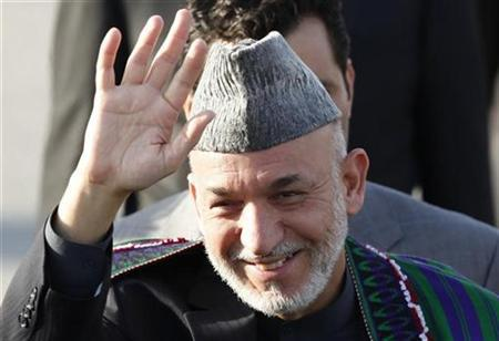 Afghanistan's President Hamid Karzai arrives at Ataturk International airport for the 25th Meeting of the Standing Committee for Economic and Commercial Cooperation (COMCEC) of the Organization of the Islamic Conference in Istanbul November 8, 2009. REUTERS/Osman Orsal