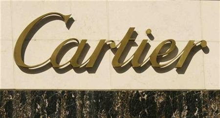 The logo of jeweler Cartier is seen on the front of the Cartier store on Rodeo Drive, home to boutiques of major designers in Beverly Hills, California August 5, 2008. REUTERS/Fred Prouser