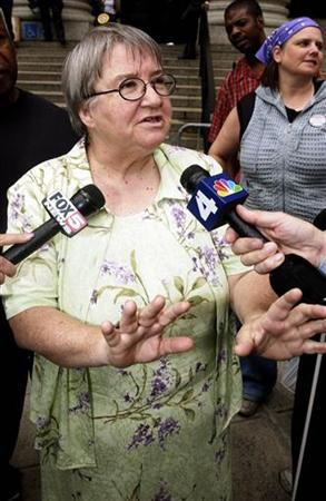 Attorney Lynne Stewart talks to reporters as she leaves federal court in New York in this June 22, 2004 file photo. REUTERS/Keith Bedford/Files