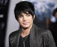 "<p>Former American Idol contestant Adam Lambert, who performed the song ""Time For Miracles"" on the soundtrack for the film ""2012"", arrives for its premiere at Regal Cinemas LA Live in downtown Los Angeles November 3, 2009. REUTERS/Danny Moloshok</p>"