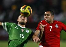 <p>Egypt's Ahmed Fathy (R) challenges Algeria's Karim Ziani during their World Cup 2010 qualifying soccer match in Cairo November 14, 2009. REUTERS/Goran Tomasevic</p>