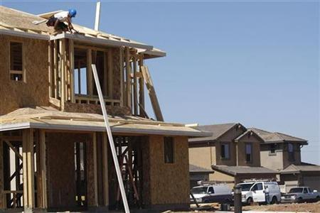 A worker constructs a house by developer KB Home in Gilbert, Arizona October 20, 2009. REUTERS/Joshua Lott