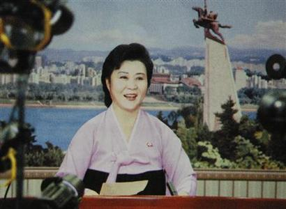 Ri Chun-hee, the main newscaster for North Korea's state TV, during a broadcast from Pyongyang, in an undated image taken by North Korean media and published in April, 2008. REUTERS/Chosun Magazine/Handout