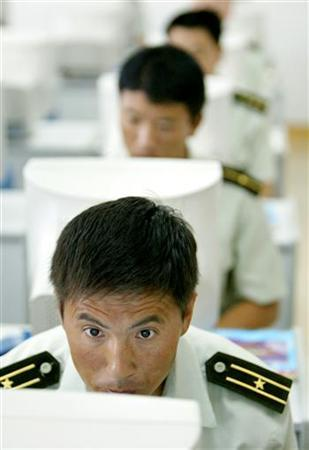 Chinese soldiers from the People's Liberation Army (PLA) learn to use computers at a library at the military base of Brigade 196 in Tianjin, southeast of China's capital Beijing, July 10, 2002. REUTERS/Andrew Wong