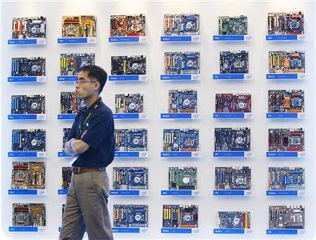 A man walks past Intel motherboard displays during the 2009 Computex exhibition in Taipei June 2, 2009. REUTERS/Nicky Loh