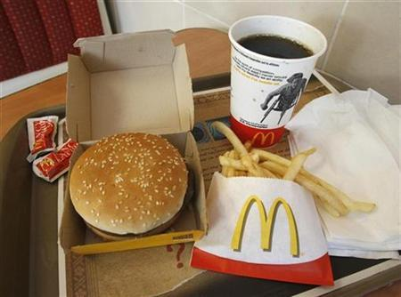 A meal consisting of a Quarter Pounder hamburger, french fries and soft-drink is pictured at a McDonald's restaurant in Los Angeles, California July 23, 2008. McDonald's on Wednesday posted a quarterly profit that topped expectations, boosted by continued strength overseas, the sale of its stake in sandwich chain Pret A Manger, and the weak dollar. REUTERS/Fred Prouser