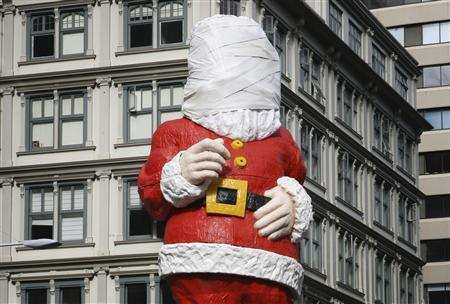 Bandages cover the face of a 20-metre (66ft) tall statue of Santa Claus in downtown Auckland November 19, 2009. The 49-year-old statue, which is placed on the busy corner every year, has undergone a NZ$100,000 ($74,000) makeover which will be revealed on Sunday. REUTERS/Fairfax NZ/John Selkirk