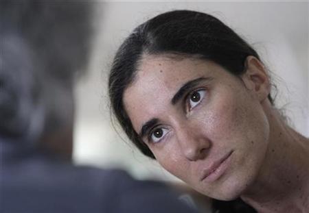 Cuban blogger Yoani Sanchez listens to a question during an interview with Reuters in her house in Havana November 9, 2009. REUTERS/Enrique De La Osa