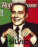 """<p>Премьер-министр Италии Сильвио Берлускони на обложке журнала Rolling Stone 23 ноября 2009 года. Итальянское издание музыкального журнала Rolling Stone удостоило премьер-министра страны Сильвио Берлускони титула """"Рок-звезда года"""", отмечая его """"стиль жизни, присущий величайшим рок-музыкантам"""". REUTERS/Handout</p>"""