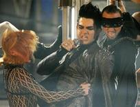 "<p>Adam Lambert (C) and dancers perform ""For Your Entertainment"" at the 2009 American Music Awards in Los Angeles, California, November 22, 2009. REUTERS/Mario Anzuoni</p>"