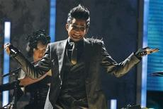 <p>Adam Lambert performs 'For Your Entertainment' at the 2009 American Music Awards in Los Angeles, California November 22, 2009. REUTERS/Mario Anzuoni</p>