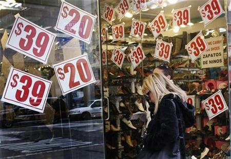 People shop for shoes at a store in New York November 23, 2009. When the U.S. holiday shopping season kicks off on the day after Thanksgiving, retailers can expect to see millions of less frightened, but even more bargain-hungry customers cross their thresholds. REUTERS/Shannon Stapleton