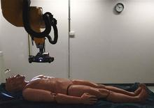 <p>Dummy 'Fred' lies on a strecher of an optical 3D and a magnetic resonance scanner for a demonstration of an autopsy without cutting open the body, in Bern November 18, 2009. REUTERS/Ruben Sprich</p>