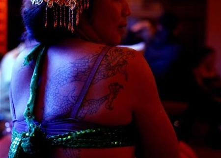 A drag queen performer is seen at a bar in Dali, Yunnan province, November 23, 2009. REUTERS/Stringer