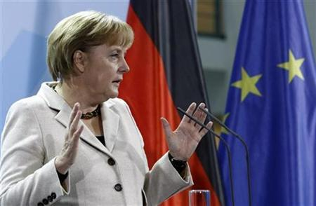 German Chancellor Angela Merkel pauses as she addresses a news conference at the chancellery in Berlin, December 1, 2009. REUTERS/Fabrizio Bensch