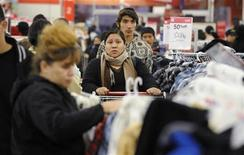 <p>Shoppers look for bargains during Black Friday sales at the Kmart in the North Hollywood area of Los Angeles November 27, 2009. There may small glimmers of hope in the economy but most Americans are not confident about their financial future and many think they are already poor, according to a new survey. REUTERS/Phil McCarten</p>