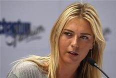 <p>Maria Sharapova of Russia answers a question during a news conference in Santiago December 1, 2009. REUTERS/Ivan Alvarado</p>