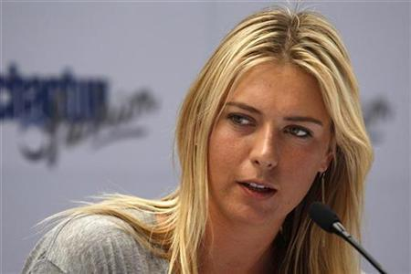 Maria Sharapova of Russia answers a question during a news conference in Santiago December 1, 2009. REUTERS/Ivan Alvarado