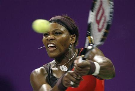 Serena Williams of the U.S. hits a return to her sister Venus Williams during their WTA Tour Championships final tennis match in Doha November 1, 2009. REUTERS/Fadi Al-Assaad