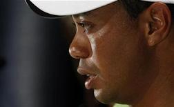 <p>Tiger Woods during a news conference in Melbourne, November 10, 2009. REUTERS/Mick Tsikas</p>