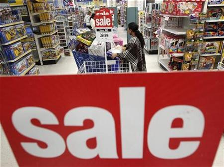 Shoppers look through the aisles during a Black Friday sales event at a ''Toys R Us'' store in Falls Church, Virginia, November 27, 2009. REUTERS/Jim Young