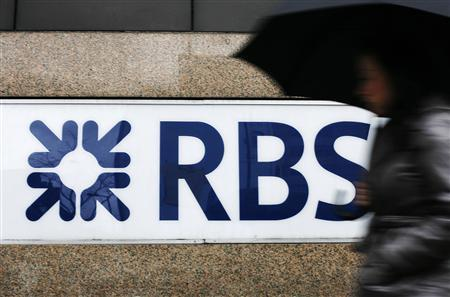 A woman walks past the offices of the Royal Bank of Scotland (RBS) in the City of London, December 3, 2009. REUTERS/Luke MacGregor