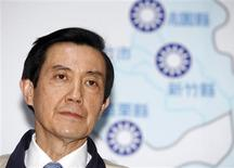<p>Taiwan President and Nationalist Party Chairman Ma Ying-jeou (C) speaks at a news conference after the results of the Taiwanese local elections, in Taipei December 5, 2009. REUTERS/Nicky Loh</p>