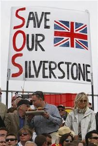 Fans sit in front of a banner during the British Formula One Grand Prix at Silverstone, central England, June 21, 2009 file photo. REUTERS/Stephen Hird