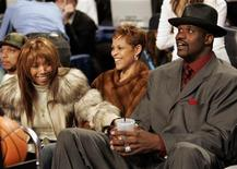 <p>Singer Brandy (L) sits in audience with Miami Heat center Shaquille O'Neal (R) and O'Neal's wife Shaunie (C) during the 2005 NBA All-Star Saturday Night in Denver, Colorado, February 19, 2005. REUTERS/John Gress</p>