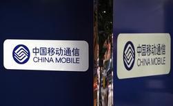 <p>L'opérateur de télécommunications China Mobile et Research in Motion vont étendre en Chine la commercialisation du BlackBerry et de ses services internet au grand public et aux petites entreprises. /Photo prise le 20 août 2009/REUTERS/Aaron Tam</p>