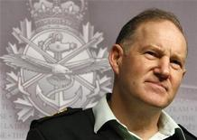 <p>General Walt Natynczyk, the chief of Canada's defense staff, listens to a question during a news conference at the Department of National Defence headquarters in Ottawa December 9, 2009. REUTERS/Chris Wattie</p>