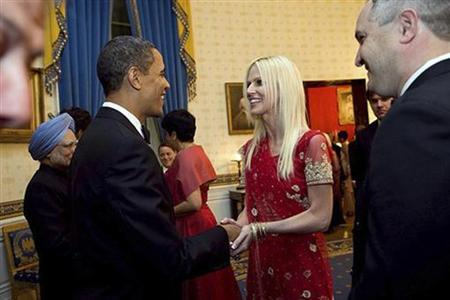 President Barack Obama (2nd L) greets Michaele Salahi (C) and her husband Tareq (R) during a state dinner for India's Prime Minister Manmohan Singh (L) at the White House in this official White House photo taken November 24, 2009 and released November 27, 2009. REUTERS/Samantha Appleton-The White House/Handout