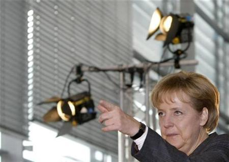 German chancellor Angela Merkel gestures during her visit of the fourth national IT-Summit in Stuttgart December 8, 2009. REUTERS/Michaela Rehle