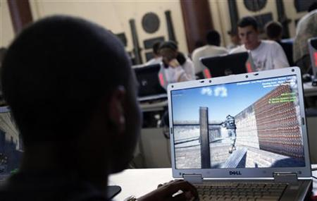 High school students play a video game in a file photo. REUTERS/Mike Segar