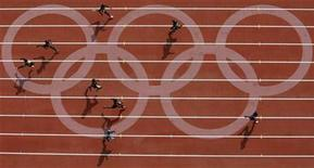 <p>Athletes compete during a men's 400m heat of the athletics competition in the National Stadium at the Beijing 2008 Olympic Games August 18, 2008. REUTERS/Kim Kyung-Hoon</p>