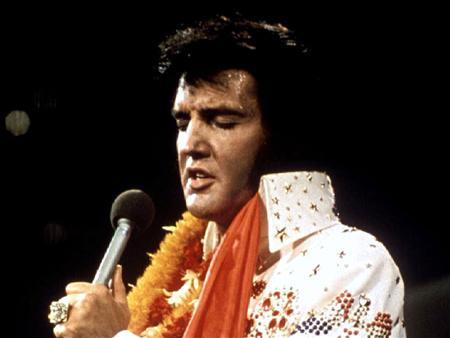 Elvis Presley performs in concert during his ''Aloha From Hawaii'' 1972 television special. REUTERS/Stringer