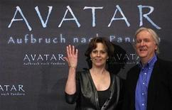 <p>Canadian director James Cameron and U.S. actress Sigourney Weaver pose for the media to promote the latest movie Avatar in Berlin, December 8, 2009. The film opens in German cinemas on December 17. REUTERS/Tobias Schwarz</p>