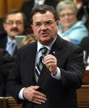 <p>Canada's Finance Minister Jim Flaherty speaks during Question Period in the House of Commons on Parliament Hill in Ottawa December 10, 2009. REUTERS/Chris Wattie</p>