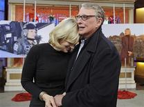 "<p>After nearly 3,000 shows, ABC newswoman Diane Sawyer (L) anchor of the ""Good Morning America"" said her farewell to the program in New York December 11, 2009. Husband, director Mike Nichols visited the set (R) in this photograph released by ABC. Sawyer will take over the ""World News"" anchor chair December 21 succeeding Charles Gibson, who will retire December 18. REUTERS/Ida Mae Astute/ABC/Handout</p>"