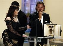 "<p>Director Warwick Thornton reacts after receiving the Camera D'Or award from actress Isabelle Adjani (L) for his film ""Samson and Delilah"" during the award ceremony of the 62nd Cannes Film Festival May 24, 2009. REUTERS/Eric Gaillard</p>"