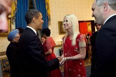<p>President Barack Obama (second left) greets Michaele Salahi (C) and her husband Tareq (R) during a state dinner for Indian Prime Minister Manmohan Singh (L) at the White House on November 24, 2009. REUTERS/Samantha Appleton-The White House/Handout</p>
