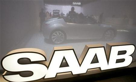 A Saab 9-X Convertible Concept car is seen behind a curtain at the exhibition stand of General Motors Corp's (GM) Swedish unit Saab during a preview day of the 79th Geneva Car Show at the Palexpo in Geneva in this March 2, 2009 file photo. REUTERS/Arnd Wiegmann/Files