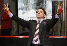 <p>Actor Robert Downey, Jr. displays his hands covered with cement during his hand and footprint ceremony in the forecourt of Grauman's Chinese Theatre in Hollywood, California December 7, 2009. REUTERS/Fred Prouser</p>