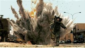 "<p>Actor Jeremy Renner runs in a scene from the Summit Entertainment film ""The Hurt Locker"" in this undated publicity photo released to Reuters December 14, 2009. The New York Film Critics Association named the film its film of the year and gave Kathryn Bigelow her second directing award in two days. Bigelow and the movie also won honors on Sunday from the Los Angeles Film Critics Association. REUTERS/Summit Entertainment/Handout</p>"