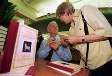 <p>FOR RELEASE WITH STORY BC-AUSTRALIA-COURTENAY - Author Bryce Courtenay (L) holds the hand of a lady after he signed a copy of his book titled 'The Night Country' for her at a Sydney bookstore in this undated file photo. REUTERS/David Gray/Files</p>