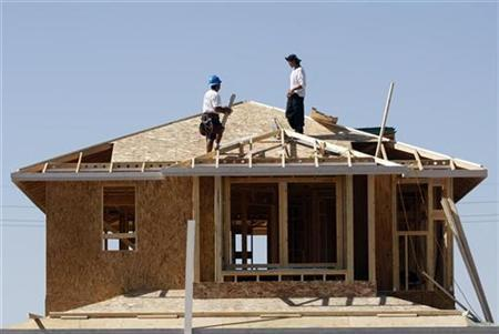 Workers construct a house by developer KB Home in Gilbert, Arizona in this file image from October 20, 2009. REUTERS/Joshua Lott/Files