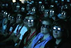 "<p>Visitors wear 3D glasses as they watch a preview of the upcoming movie ""Avatar"" during the 40th annual Comic Con Convention in San Diego July 23, 2009. REUTERS/Mario Anzuoni</p>"