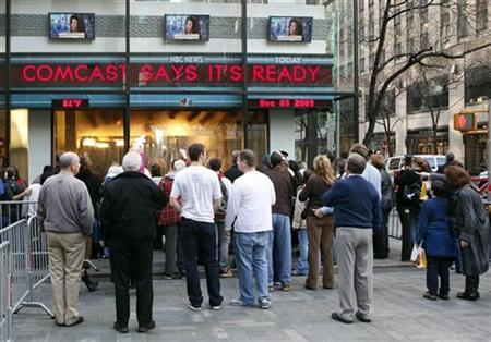 The news ticker outside the Today Show in New York announces GE's sale of NBC to Comcast, December 3, 2009. REUTERS/Chip East