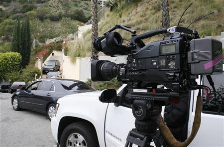 A television camera stands in the street near the driveway to the Hollywood Hills home of the late actress Brittany Murphy in Los Angeles, California December 21, 2009. REUTERS/Fred Prouser